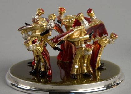 Ten Lords a-Leaping. On a silver plinth dressed in red and gold wearing crowns
