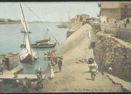 Colour printed photographic postcard depicting a river scene inCairo, Egypt, in the early years of the 20th century.