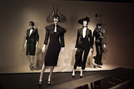 Four fashion mannequins dressed in women's black outfits