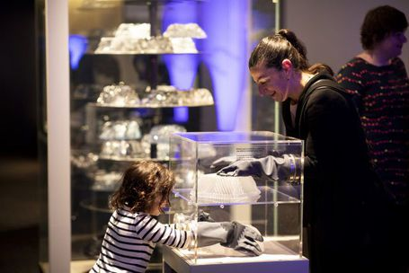 Woman and child interacting with gel bundt cakes