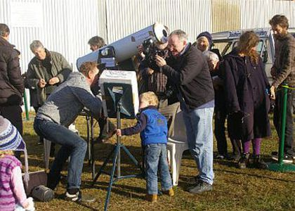 Martin George (in front of telescope) showing the transit