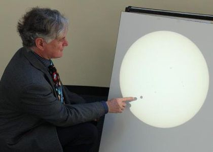 Mark Rigby, the Curator of the Brisbane Planetarium, points out Venus on the Sun