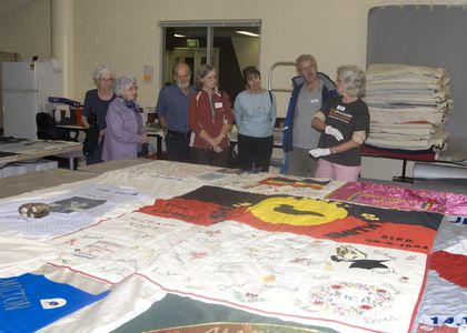 Volunteers work on the quilts