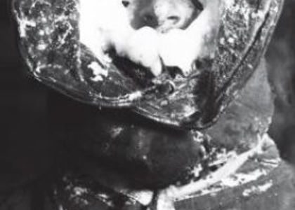 C.T. Madigan covered in ice in a Burberry helmet, on Mawson's expedition