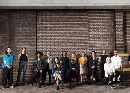 Image of group of artists in front of Powerhouse Museum