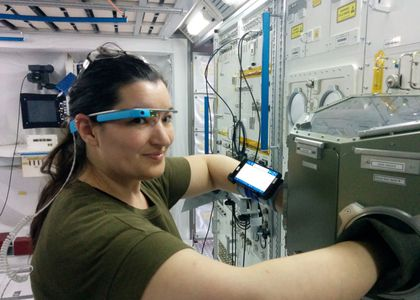 A woman wearing goggles performs a science experiment