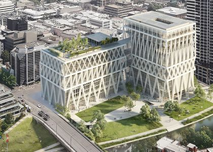 Artist impression of large museum on riverbank
