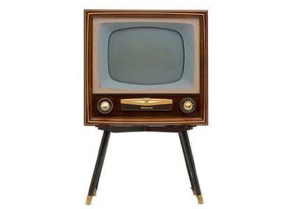 Old television in a wooden case on stand with 2 large gold knobs on the front