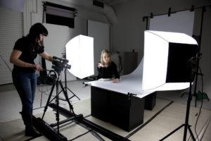 Curatorial volunteer Alysha Buss assists Leonie Jones in the photography studio