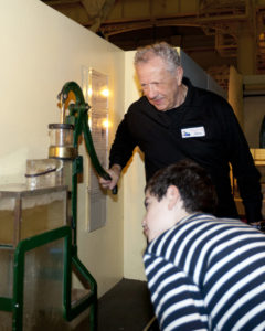A volunteer demonstrates a pump in The Steam Revolution exhibition