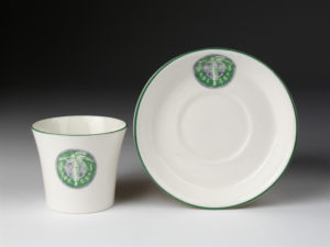 Cup and saucer with Women's Social and Political Union emblem, H.M Williamson & Sons, Bridge Pottery, Britain, c. 1910, V&A collection, C.37C-1972 and C.37D-1972
