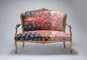 Picture of ornate pink coloured couch