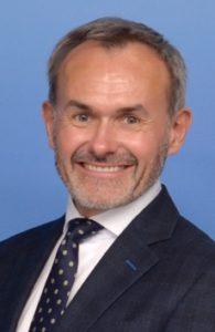 Headshot of man in suit