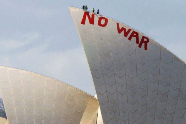 """Will Saunders and David Burgess climb the Sydney Opera House to paint the slogan """"NO WAR"""", 2003, AAP Image/Mick Tsikas"""