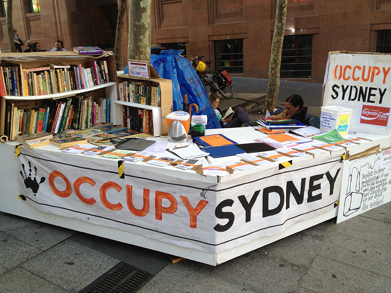 Street structure, bookshelves with Occupy Sydney banner