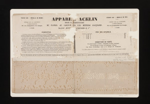 Piece of paper punched to be used in a Jacquard weaving machine and found in a box with the letters of Charles Babbage.