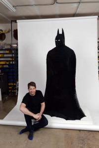 Artist Nathan Sawaya with his LEGO creation of The Darkest Knight