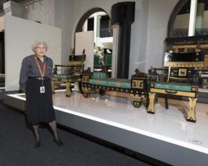 Portrait of Meg Stevenson, volunteer, next to Hope Suite in ICONS exhibition