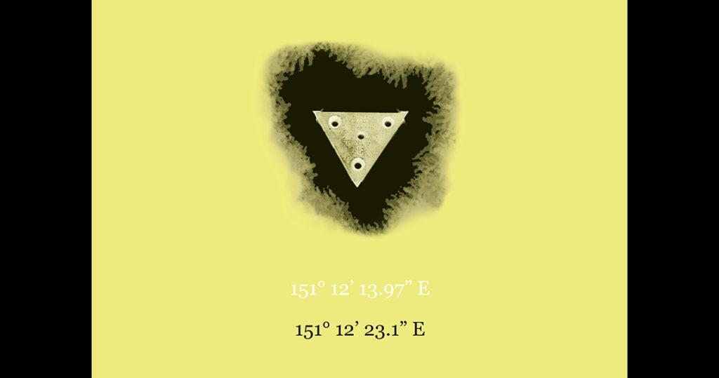 Triangular shape with 4 drill holes in the centre of the image surrounded by black shadows on a yellow background