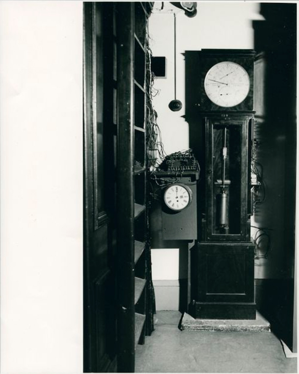 black and white image of two historical clocks