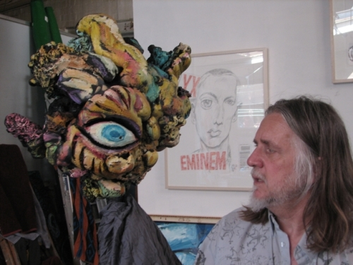 Portrait of George Gittoes with artwork