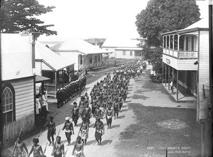 Malietoa supporters and United Sates marines on the streets of Apia, 1899, published by Kerry and Co.