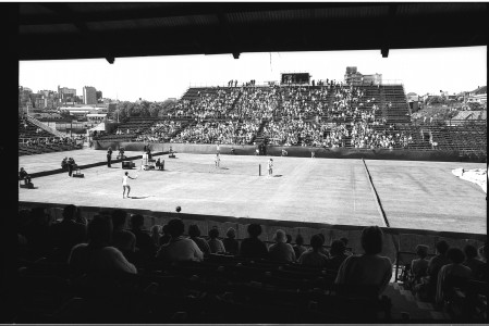 Black and white image of women's tennis match in progress