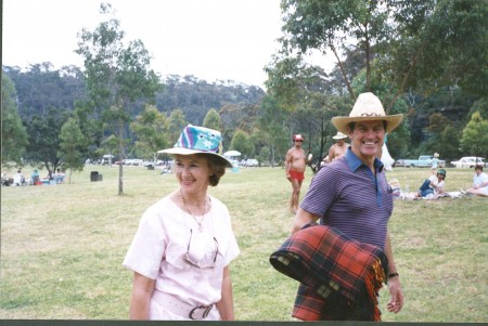 Photograph of a man and woman with cowboy hats at a park