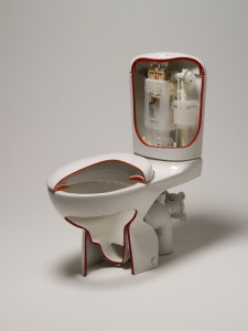 Sectioned Caroma 'Smartflush' toilet suite