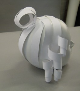 Back view of ,mannequin's head with paper hairstyle