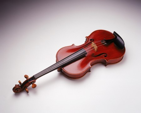 Viola made by John Devereux on white table