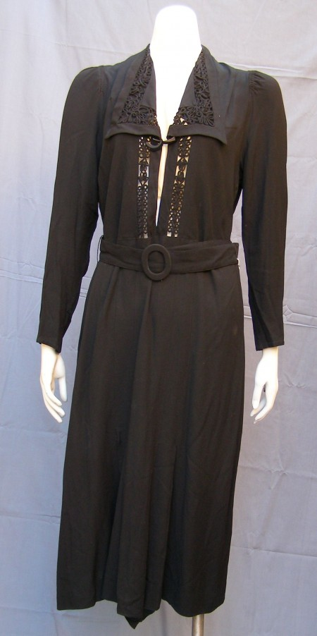 Ladies Black Crepe de Chine Dress c.1930-1940 Has very low neckline which is held together at the collar with a black and silver bakelite art deco brooch.