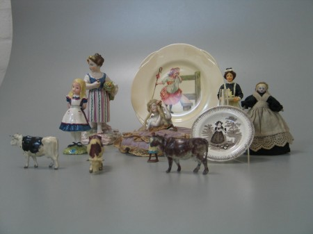 Collection of ceramic figures animals and plates with two fabric dolls