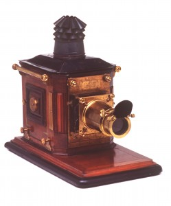 Magic Latern, large polished mahogany box with brass fittings and blued ironn chimney.