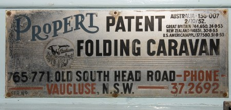"Aged graphic sign that reads"" Propert - Patent Folding caravan - 765771. Old South head Road Vaucluse N.S.W - Phone 37.2692"""