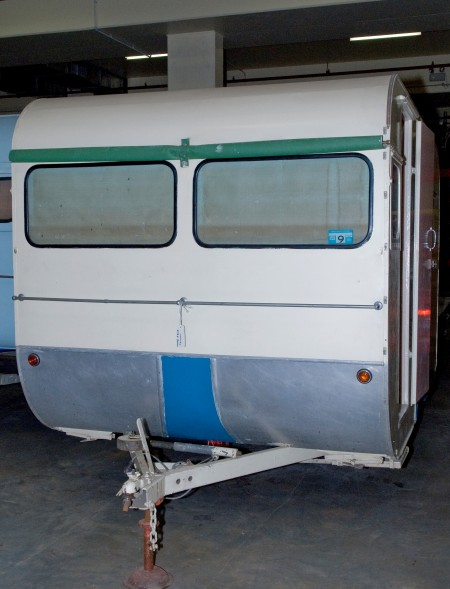 Front view of sleek aluminium-clad model Caravan