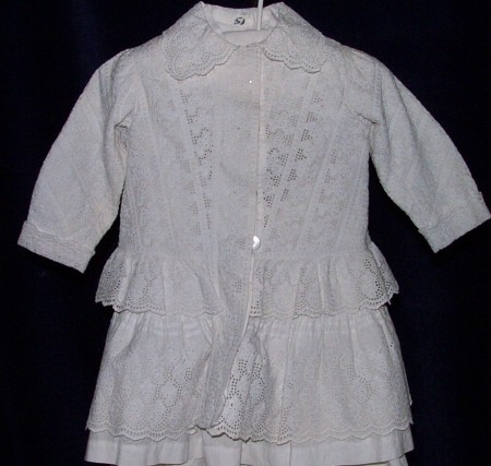 James Somervilles pelisse, of white broidery anglaise and frills, buttons up from the front
