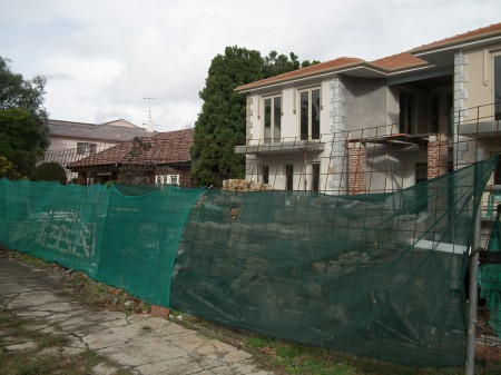 Exterior street view of a house under construction