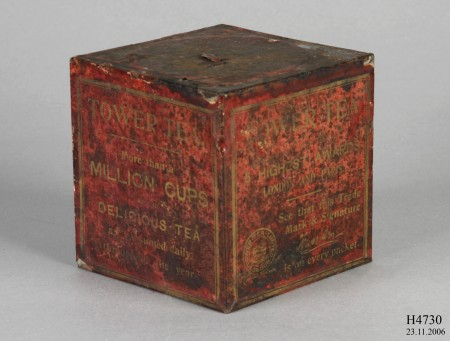 Red aged box of unopened Tower Tea