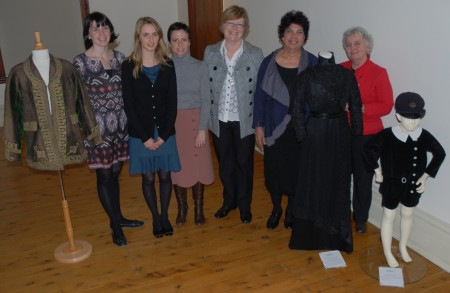 Rebecca Evans, Rosie Cullen, Sarah Pointon, Lindie Ward, Dawn Casey and Rebecca Pinchin standing with a couple of mannequins from the exhibition