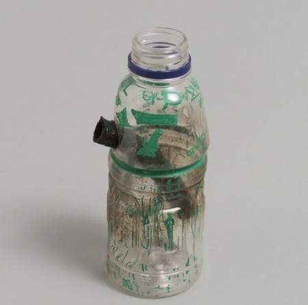 Homemade bong made from Powerade bottle and hosepipe