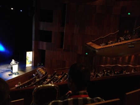 Inside the Heath Ledger Theatre of Perth's new State Theatre, seated position view of a person presenting lectern on a stage