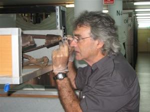 Botanist, John Ford, taking timber samples from the Museum's sledges