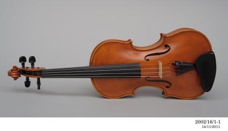 Violin lying on its side made by Harry Vatiliotis