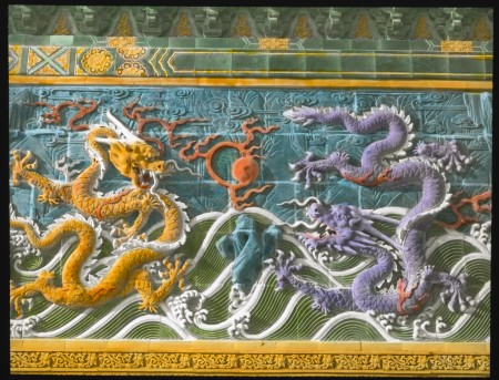 Glass lantern slide with detailed dragons in an ocean setting