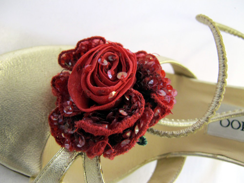 Jimmy Choo gold shoe with red flower