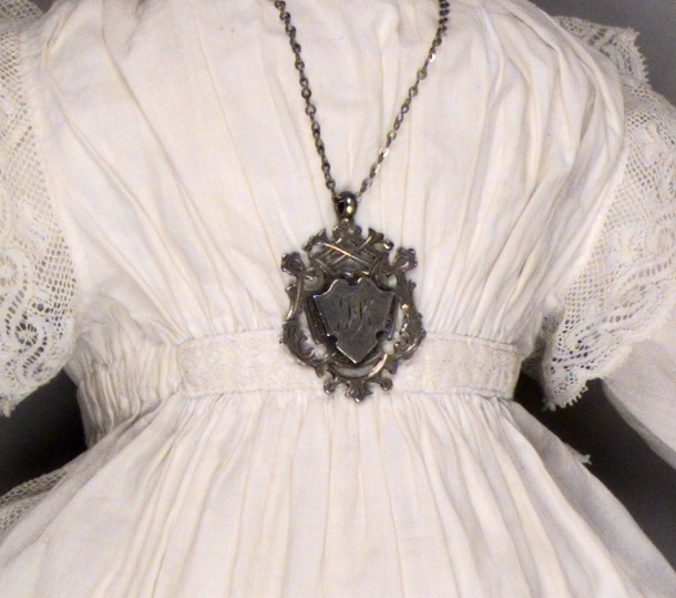 A detail of the fine sewing and Florence's medal on her doll