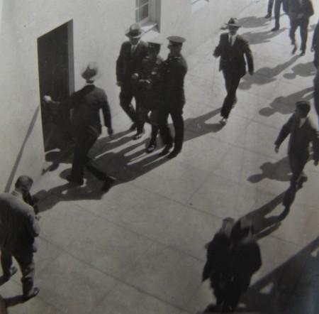 Captain de Groot under arrest and being escorted away at opening of Sydney Harbour Bridge 1932