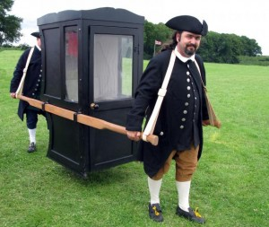 Chairmen demonstrating how a sedan chair was carried
