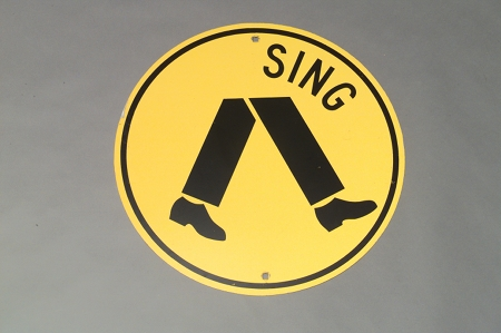 'Sing' crossing sign manipulated by Richard Tipping